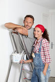 Couple painting walls of their new home — Stock Photo