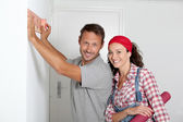 Couple choosing color of new paperwall — Stock Photo