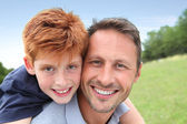 Closeup of father and son in countryside — Stock Photo