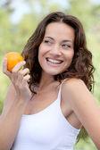 Closeup of woman eating an orange — Stock Photo