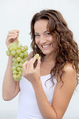 Closeup of woman eating grapes — Stock Photo
