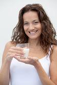 Closeup of beautiful woman drinking milk — Stock Photo