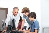 Teenagers in computing class — Stock Photo