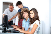 Group of students sitting in classroom — Foto Stock