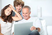 :Family at home with laptop computer — 图库照片