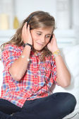 Teenager wth headphones and laptop computer — Stock Photo