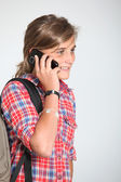 Teenaged girl with mobile phone — Stock Photo
