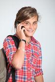 Teenaged girl with mobile phone — Stock Photo