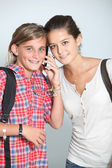 Teenaged girls with mobile phone — Stock Photo