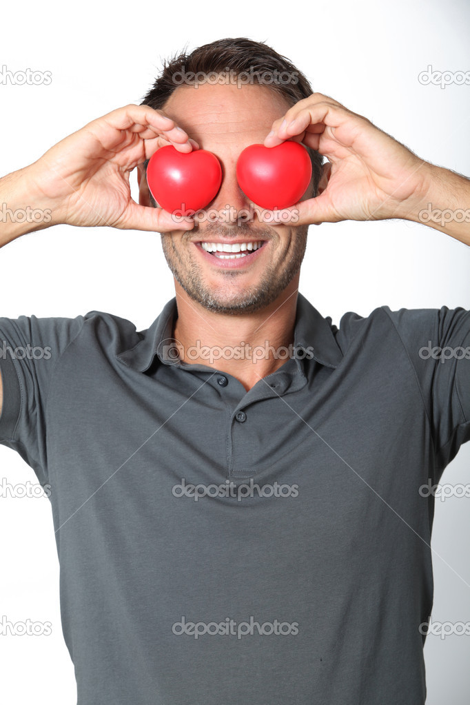 Man covering his eyes with 2 hearts — Stock Photo #18264725