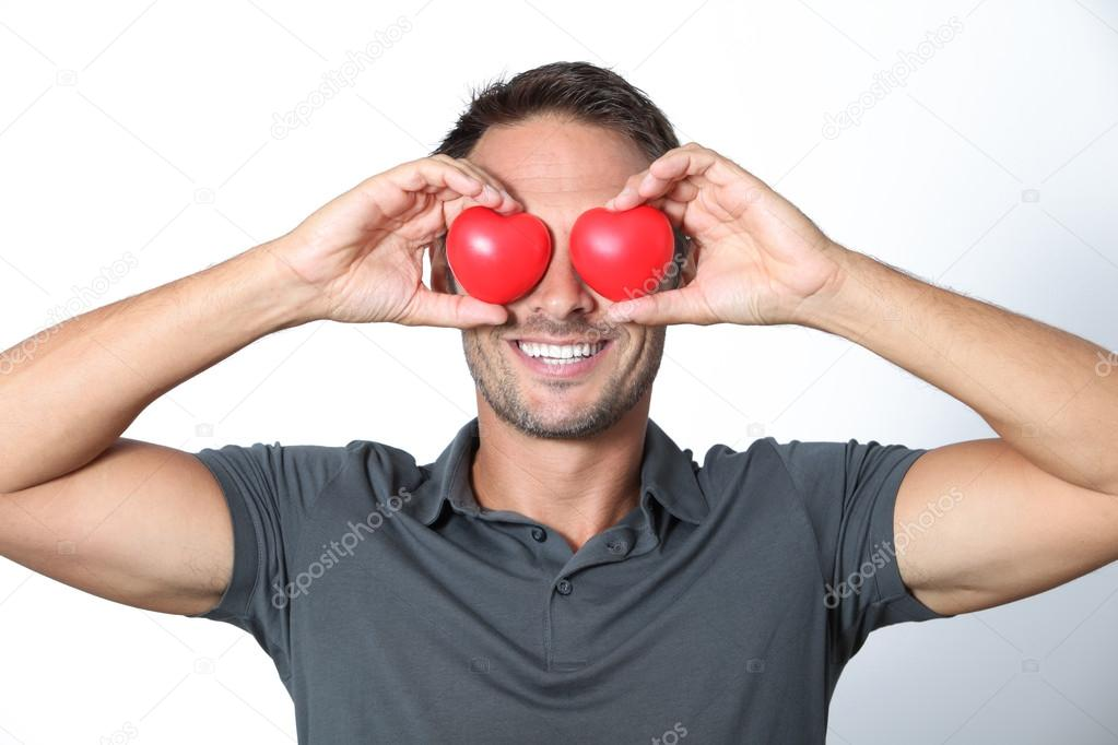 Man covering his eyes with 2 hearts — Stock Photo #18264729