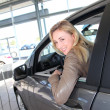 Woman sitting in brand new car — Stock Photo