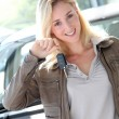 Stock Photo: Smiling woman holding brand new car key