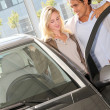 Couple looking to buy a new car — Stock Photo