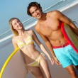 Couple at the beach with surfboard — Stock Photo #18273723