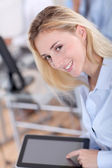 Protrait of office worker using electronic tablet — Stock Photo