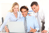 Cheerful business team in meeting — Stock Photo