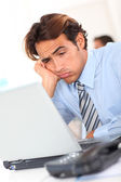 Businessman with tired look at work — Foto de Stock