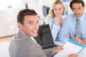 Couple with real-estate agent in office — Stockfoto