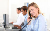 Office worker answering the phone — Stock Photo