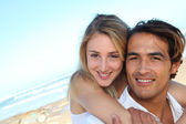 Happy couple in holidays at the beach — Stock Photo