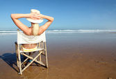 Woman relaxing at the beach — Stock Photo