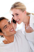 Couple receiving a phonecall — Stock Photo