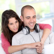 Young couple at home listening to music on internet — Stock Photo #18297007