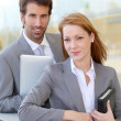 Business working outside on electronic tablet — Stock Photo #18296749
