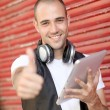 Smiling man using electronic tablet in the street — Foto Stock