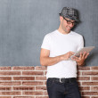 Stylish guy using electronic tablet — Stock Photo