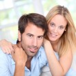 Young couple relaxing in sofa at home — Stock Photo #18297835