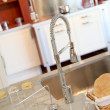 closeup on kitchen faucet — Stock Photo