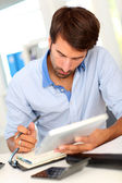 Portrait of office worker using electronic tablet — Stock Photo