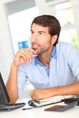 Office worker with thoughtful look — Stock Photo
