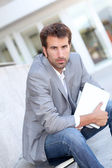 Relaxed businessman sitting outside with tablet — Stock Photo