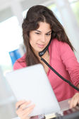 Closeup on office worker using electronic tablet — Stock Photo