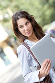 Girl in the street using electronic tablet — Stock Photo