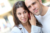 Portrait of young couple in town with smartphone — Stock Photo