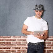 Stylish guy using electronic tablet — Stock Photo