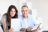 Workmates working on project with electronic tablet — Stock Photo