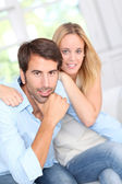 Young couple relaxing in sofa at home — Stock Photo