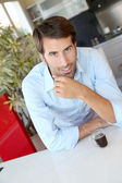 Handsome man having coffee at home — Stock Photo
