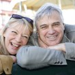 Senior couple sitting on a public bench — Stock Photo