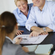 Senior couple meeting architect for building project — Stock Photo #26964909