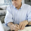 Senior businessman working from home — Stock Photo