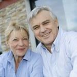 Cheerful senior couple looking at camera — Stock Photo