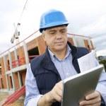 Building entrepreneur using digital tablet — Stock Photo
