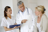 Medical giving prescription to patient — Stock Photo