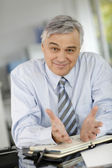 Senior businessman meeting client in office — Stock Photo
